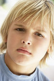 Portrait Of Young Boy Frowning — Stock Photo