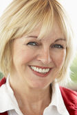 Portrait Of Middle Aged Woman Smiling At Camera — Stock Photo