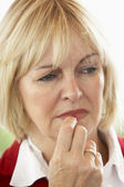 Portrait Of Middle Aged Woman Frowning — Stock Photo