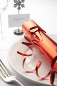Place Setting With Christmas Cracker — Stock Photo