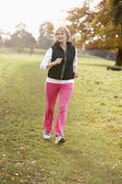 Senior Woman Power Walking In The Park — Stock Photo
