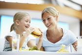 Mother And Daughter Having Lunch Together At The Mall — Stock Photo