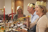 Friends Wearing Party Hats At A Dinner Party — 图库照片