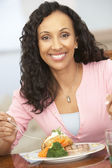 Woman Enjoying A Meal At Home — Stockfoto