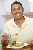 Man Enjoying A Meal At Home — Stockfoto