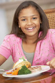 Young Girl Enjoying A Meal At Home — Stock Photo