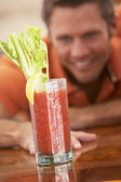 Man Reaching For A Bloody Mary — Stock Photo