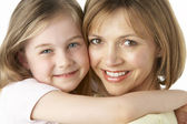 Mother And Daughter Smiling And Hugging — Stock Photo