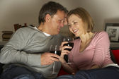 Couple Drinking Wine And Not Watching Television — Stock Photo