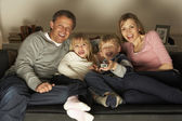 Family Watching Television Together — Stock Photo