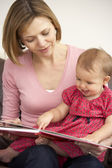 Mother And Baby Daughter Reading Book — Stock Photo