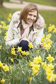 Woman Kneeling In Daffodils — Stock Photo