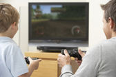 Father And Young Son Playing With Game Console — Foto de Stock