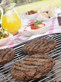 Burgers Cooking On Barbeque Grill — Stock Photo