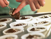 Putting Chocolate Cupcake Mix Into Baking Tin — Stock Photo