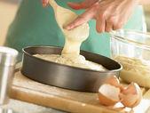 Pouring Cake Mixture Into Baking Tin — Stock Photo