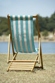 Lone Beach Chair Sitting Next To Water — Stock Photo