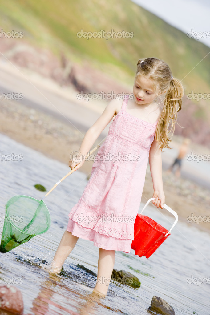 Young girl at beach with net and pail — Stock Photo #4780210