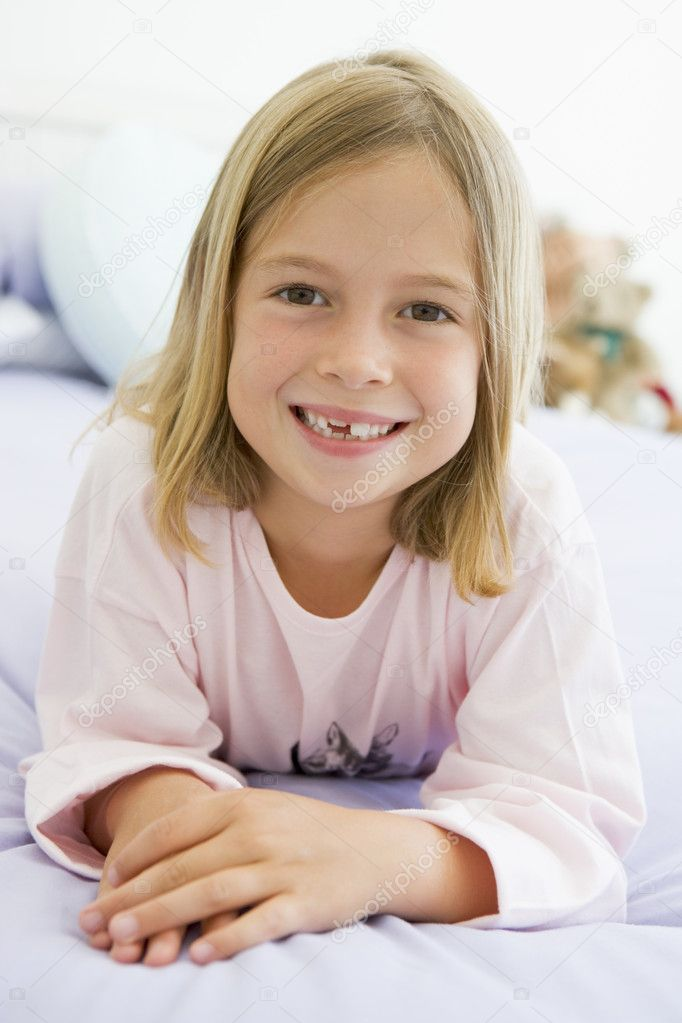 Young Girl Lying On Her Bed In Her Pajamas  Stock Photo #4780378