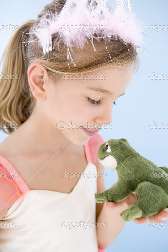 Young girl in princess costume kissing plush frog — Stock Photo #4781997
