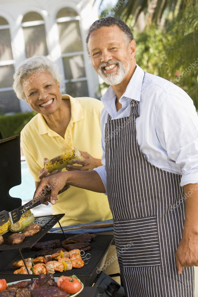 Couple Cooking On A Barbeque — Stock Photo #4785010