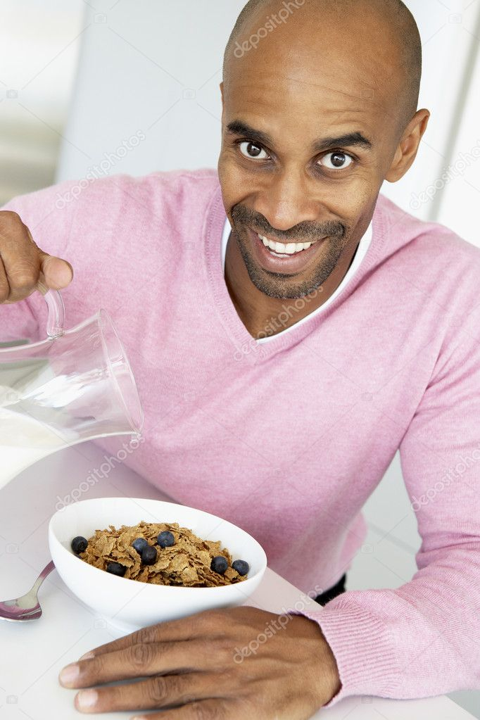 Middle Aged Man Eating Healthy Breakfast — Stock Photo #4787302