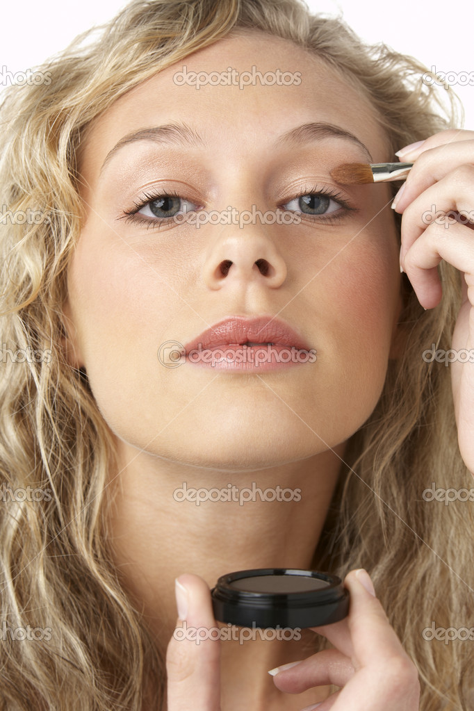 Young Woman Applying Make-Up — Stock Photo #4788215