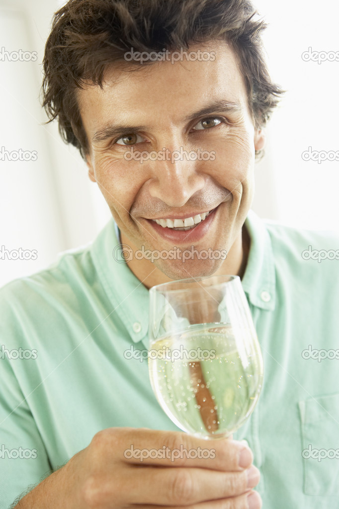Man Drinking A Glass Of White Wine — Stock Photo #4788886