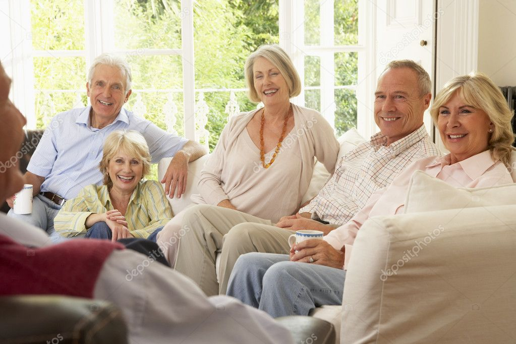 Friends Socializing At Home  Stock Photo #4789077
