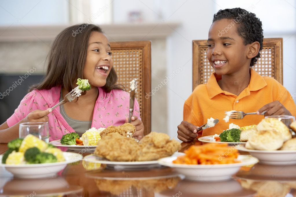 Brother And Sister Having Lunch Together At Home - Stock Image