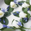 Box Filled With White Rose Corsages - Stock Photo