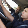 Stock Photo: Ambulance driver and colleague on the way to an emergency