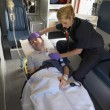 Stock Photo: Paramedic with patient in ambulance