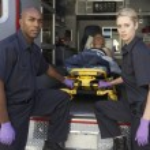 Paramedics preparing to unload patient from ambulance — Stock Photo