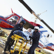 paramedics unloading patient from medevac — Stock Photo #4790218