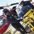 Paramedics unloading patient from Medevac — Stock Photo #4790221