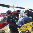 paramedics unloading patient from medevac — Stock Photo #4790224