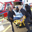 Paramedics unloading patient from Medevac - Stock Photo
