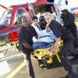 paramedics unloading patient from medevac — Stock Photo #4790225