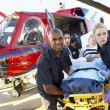 Paramedics unloading patient from Medevac — Stock Photo #4790226