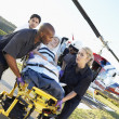 Paramedics unloading patient from Medevac — Stock Photo