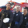 Portrait of paramedics standing in front of Medevac — Stock Photo