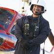 Portrait of paramedic standing in front of Medevac — Stock Photo