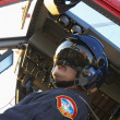 Stock Photo: Pilot flying Medevac