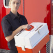 Paramedic standing by ambulance with medical kit — Stockfoto