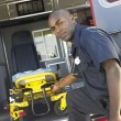 Stock Photo: Paramedic removing empty gurney from ambulance