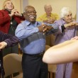 Senior adults in stretching class — Stock Photo #4790408