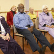 Stock Photo: Senior adults in a stretching class