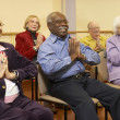 Senior adults in a stretching class — Stock Photo #4790410
