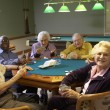 Senior adults playing bridge — Stock Photo